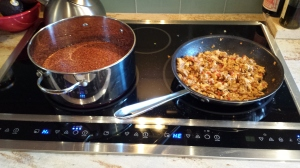 Quinoa's simmering, and chicken is almost ready to go.